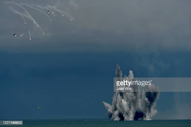 Two US-made F-16V fighter aircraft releases flares after dropping bombs during the annual Han Kuang military drills in Taichung on July 16, 2020. -...