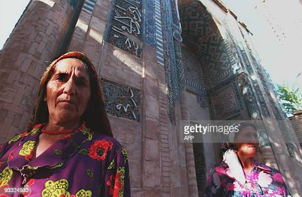 Two Uzbek woman walk past a mausoleum in the ShakhyZynda Cemetery in the town of Samarkand Uzbekistan on the old Silk Road trade route 09 August The...