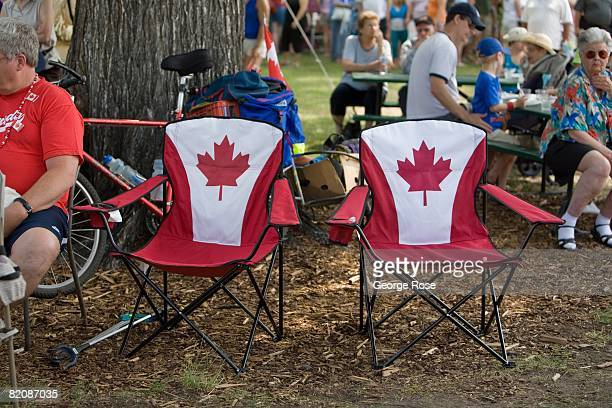 Two vacant Canadian maple leaf flag chairs are seen in this 2008 Penticton British Columbia Canada Canada Day summer photo Canada Day is the Canadian...