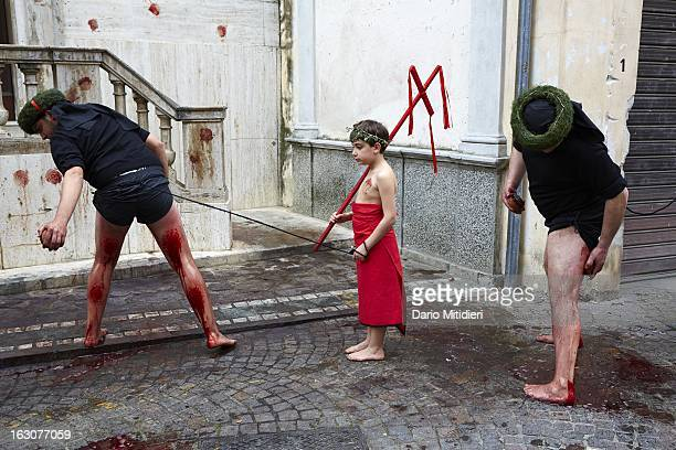 Two Vattienti beat their legs with a Cardo a piece of cork containing 13 small pieces of glass in front of a church in Nocera Terinese Italy April 7...