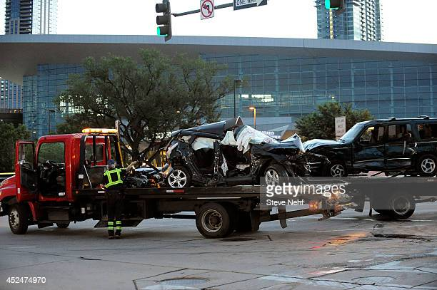 Two vehicles involved in an accident are towed away from the scene that closed the intersection of Speer Blvd and W Colfax Ave Monday morning The...