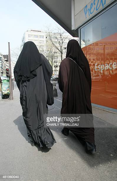 Two veiled women walk in a street in Paris on April 21 2010 French National Assembly is to debate on May 11 on a controversial law project to ban the...