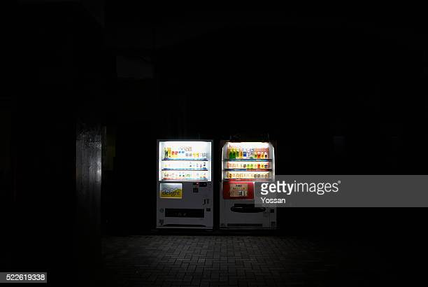 Two Vending Machines Illuminated at Night