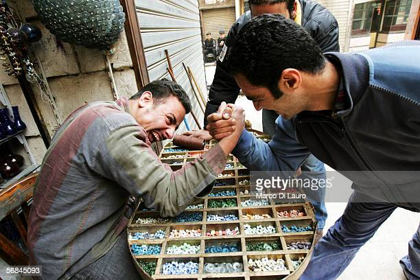 Two vendors play with each others in the Khan al-Khalili bazaar on February 8, 2006 in Islamic Cairo, Egypt. The Khan is one of the largest bazaars...