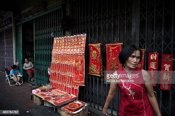 Two vendors selling goods for the upcoming Lunar New Year talk in the Chinatown area of Bangkok on February 18 2015 The Lunar New Year of the Sheep...