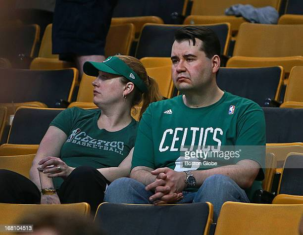 Two very unhappy looking Celtics fans in the stands after the game and the season ended for Boston The Boston Celtics hosted the New York Knicks for...