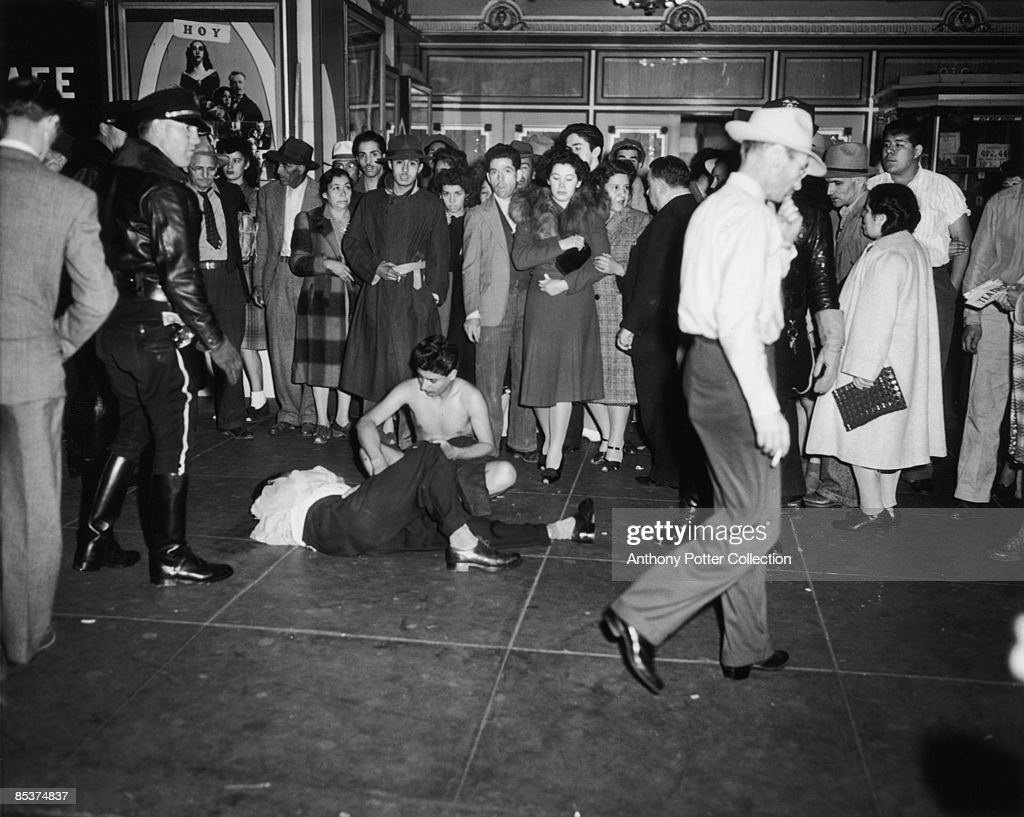 Two victims, one stripped, one badly beaten, of a gang of servicemen at a cinema in Los Angeles, California, during the Zoot Suit Riots, 7th June 1943. The riots broke out as tensions rose between between servicemen stationed in the city and Latino youths, amongst whom zoot suits were the latest fashion.