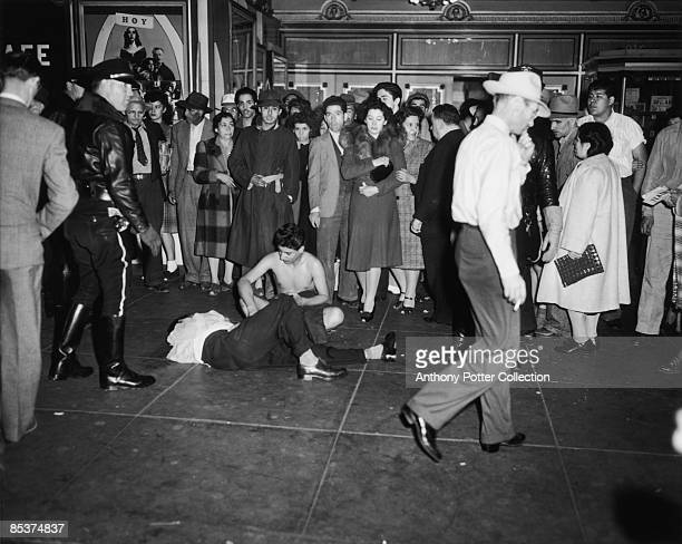 Two victims, one stripped, one badly beaten, of a gang of servicemen at a cinema in Los Angeles, California, during the Zoot Suit Riots, 7th June...