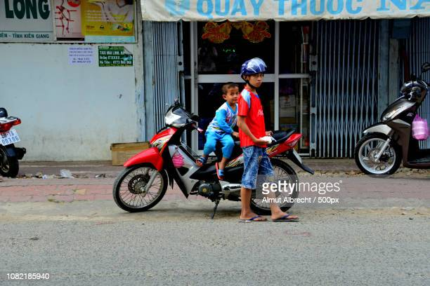 two vietnamese boys and a moped in HaTien, Vietnam