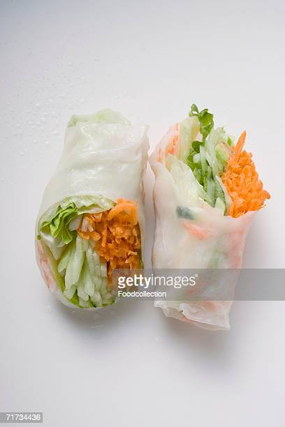 Two Vietnamese rice paper rolls with vegetable filling