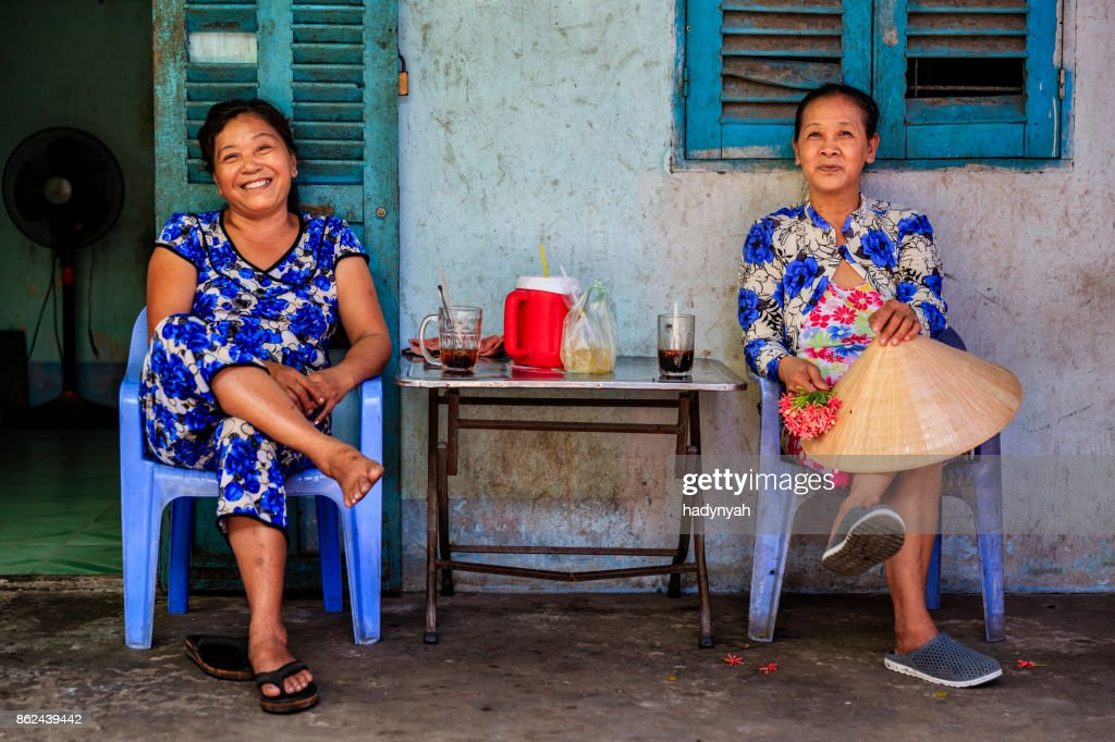 Two Vietnamese women drinking coffee together, Mekong River Delta, Vietnam : Stock Photo
