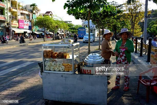 two vietnamese women sell streetfood