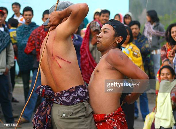 Two villagers hit each other using canes at Mount Bromo in Probolinggo East Java province on November 7 2009 The fights were conducted as part of...