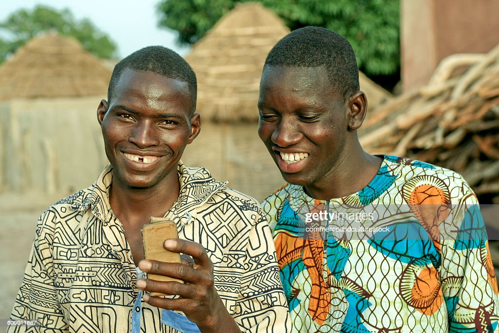 Two villagers with a mobile phone : Stock Photo