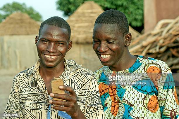 Two villagers with a mobile phone