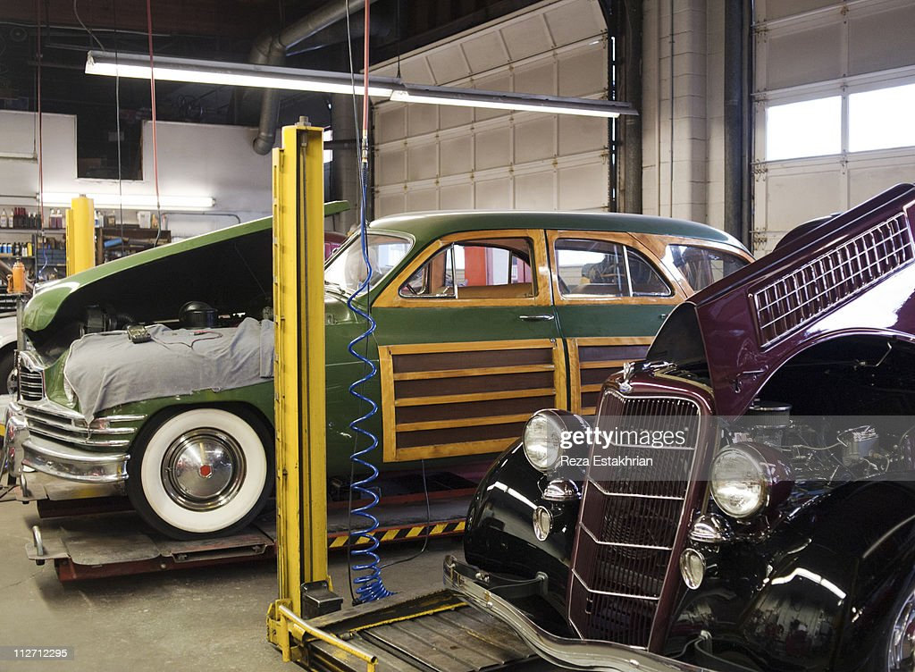 Two Vintage Autos Wait For Repair Stock Photo | Getty Images
