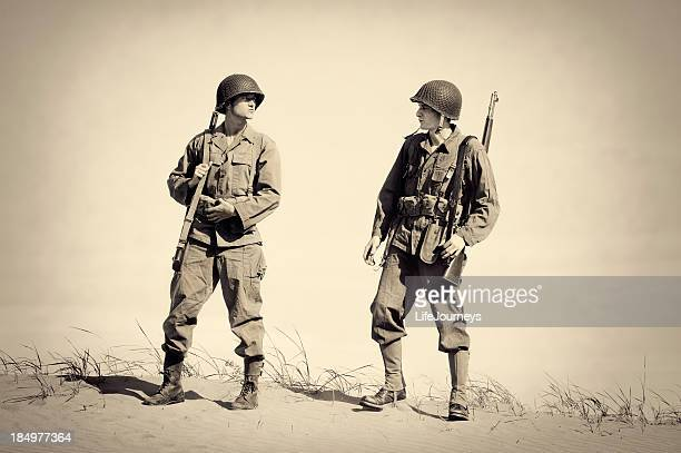 two vintage wwii soldiers - world war ii stock pictures, royalty-free photos & images