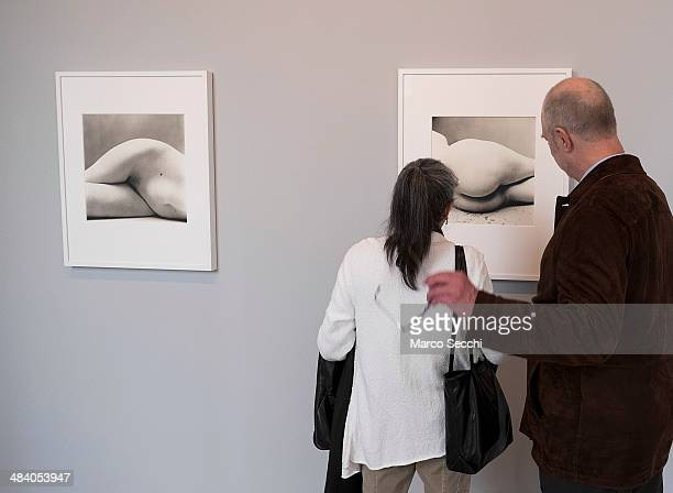 Two visitors admire photographs by Irving Penn during the press preview of the new exhibition at Palazzo Grassi on April 11 2014 in Venice Italy The...