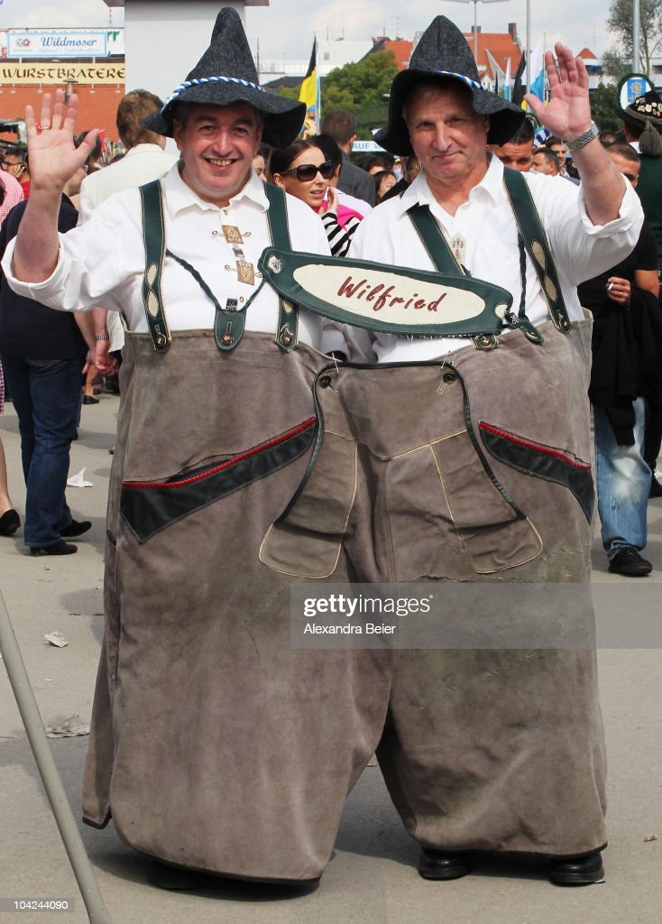 Two visitors are dressed in a huge Bavarian Lederhose leather pants during the opening day of the Oktoberfest at Theresienwiese on September 18, 2010 in Munich, Germany. 2010 marks the 200th anniversary of Oktoberfest.The Oktoberfest tradition started in 1810 to celebrate the October 12th marriage of Bavarian Crown Prince Ludwig to the Saxon-Hildburghausen Princess Therese. The citizens of Munich were invited to join in the festivities which were held over five days on the fields in front of the city gates. The main event of the original Oktoberfest was a horse race. The world's biggest beer festival will last this year from September 18 to October 4.