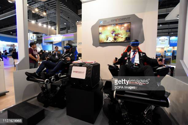L´HOSPITALET CATALONIA SPAIN Two visitors are seen having fun with a video game of war with virtual reality technology at the Mobile World Congress...
