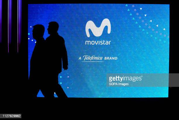 L´HOSPITALET CATALONIA SPAIN Two visitors are seen walking in front of the Movistar stand at the Mobile World Congress in Barcelona