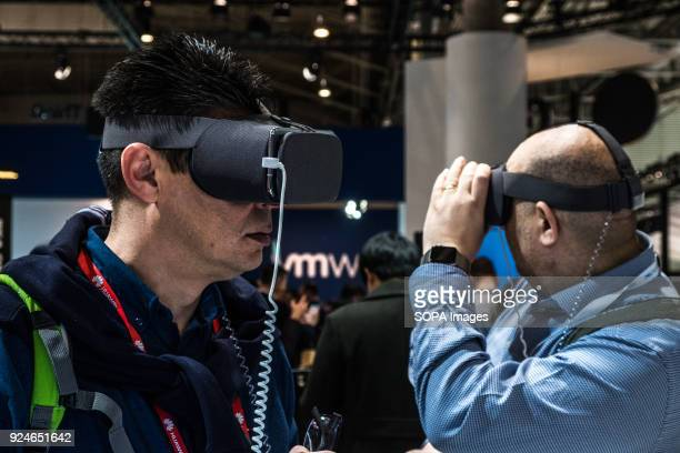 Two visitors experience the virtual reality of LG Oled Full Vision screens at the Mobile WOrld CongressThe Mobile World Congress held in Barcelona...