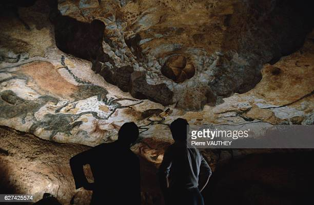 Two Visitors Inside Lascaux II Grotto in France