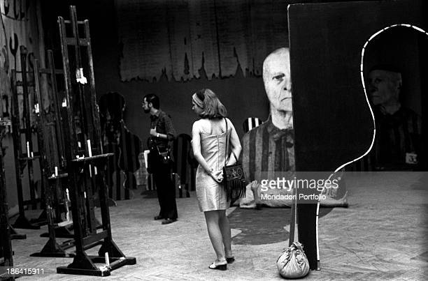 Two visitors observing the installation Reminiscences by Polish artist Jozef Szajna at the 35th Art Biennale Venice 1970