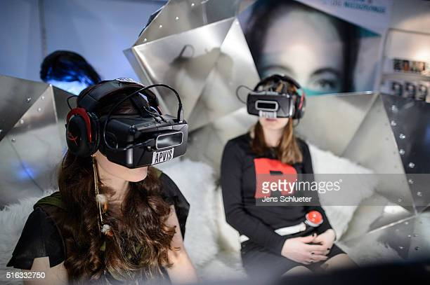 Two visitors sit with data eyeglasses during the Leipzig Book Fair 2016 on March 18, 2016 in Leipzig, Germany. From March 17 to March 20 more than...