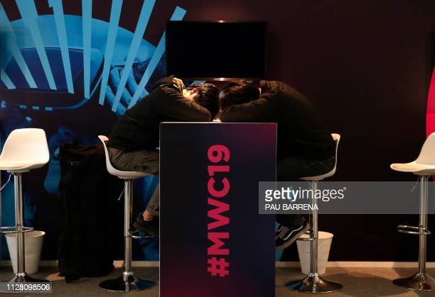 Two visitors take a nap on the last day of the Mobile World Congress in Barcelona on February 28 2019 Phone makers focused on foldable screens and...