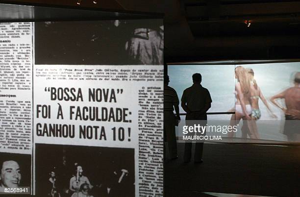 Two visitors watch a showing as part of an exhibition to celebrate the 50th anniversary of Brazilian movement and musical style 'Bossa Nova' at the...