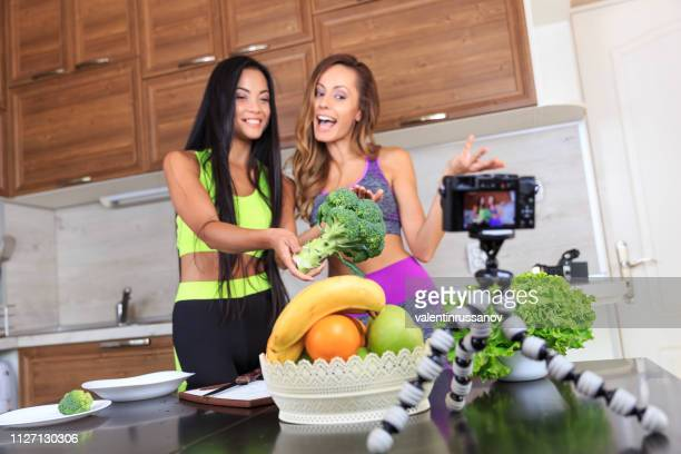 two vloggers filming video for healthy eating - influencer stock pictures, royalty-free photos & images