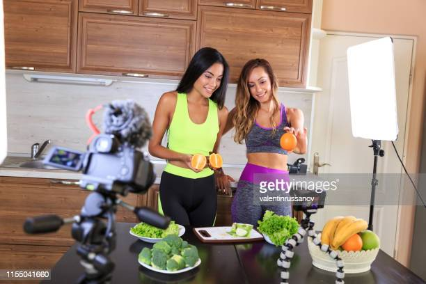 two vloggers filming video for healthy live style - very young webcam girls stock photos and pictures
