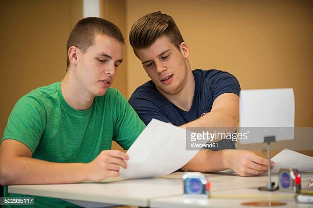 Two vocational school students in class room discussing