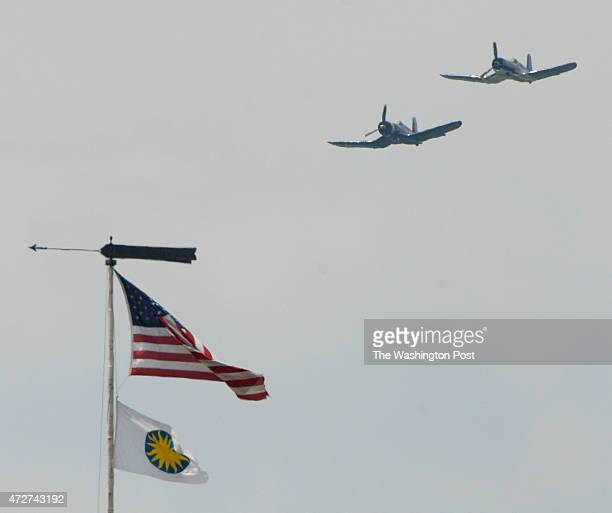 Two Vought F4U Corsairs fly past the Smithsonian castle as World War II planes fly over the National Mall to makr the 70th anniversary of Victory in...