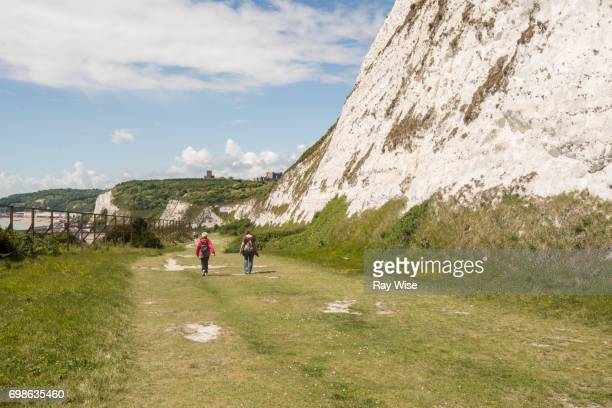 two walkers on the white cliffs of dover - dover england stock pictures, royalty-free photos & images