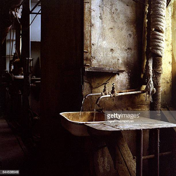 two water taps in an old plant - bacia de lavagem imagens e fotografias de stock