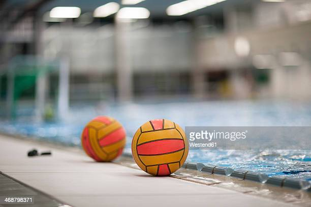 two water-polo balls outside pool - water polo stock pictures, royalty-free photos & images