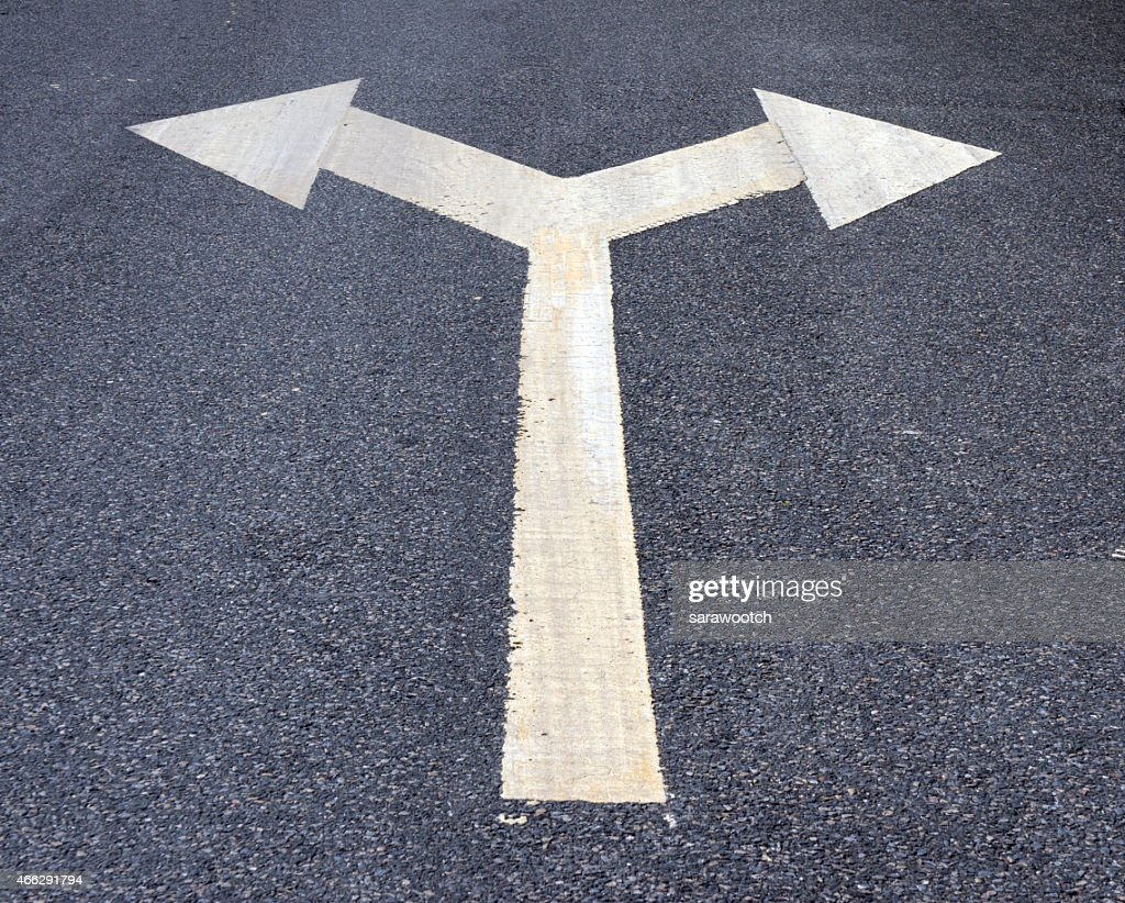 Two Way Arrow Symbol On An Asphalt Road Surface Stock Photo Getty