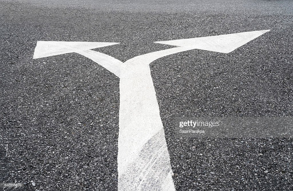 Two Way Arrows Symbol On Asphalt Road Stock Photo Getty Images