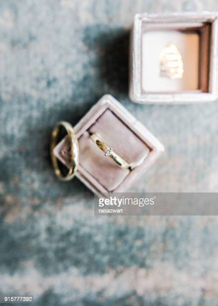 two wedding rings in a ring box - 結婚指輪 ストックフォトと画像
