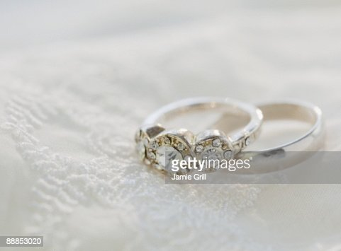 Two Wedding Rings On Bed Stock Photo