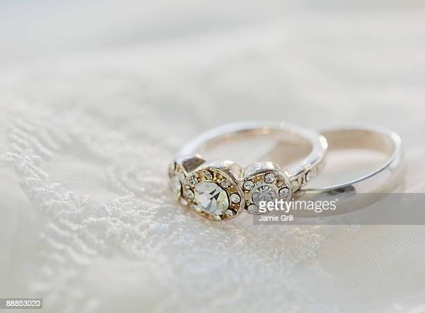 two wedding rings on bed - wedding ring stock pictures, royalty-free photos & images