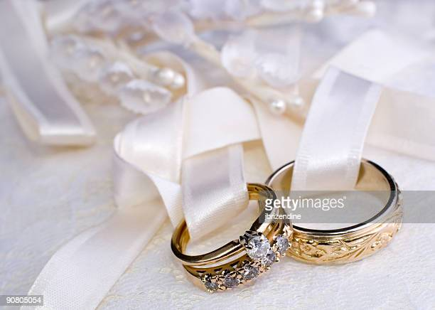 Two wedding rings tied to a pillow