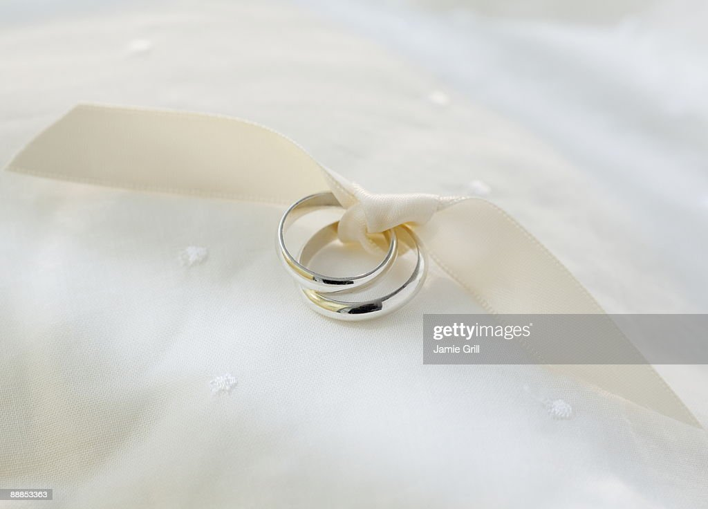 Two Wedding Rings Tied With Ribbon Stock Photo