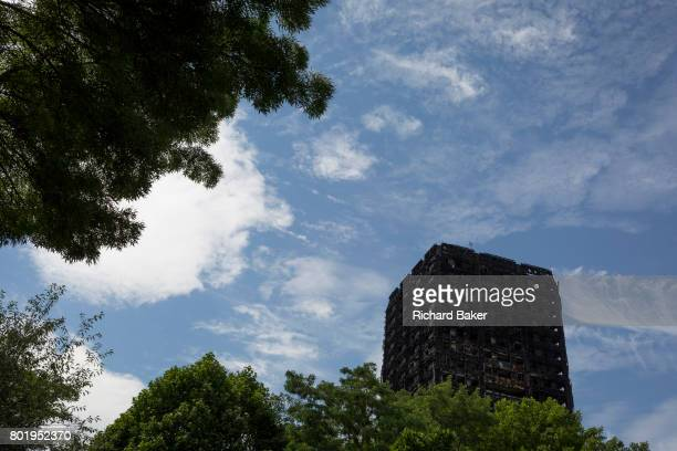 Two weeks after the devastating fire that killed an unspecified number of people in Grenfell Tower the charred and blackened tower block remains a...
