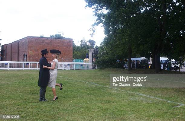 Two well dressed racegoers share a private moment during the Royal Ascot race meeting After over a decade of Labour Government in Great Britain the...