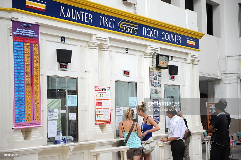 Two western women buy train ticket at the Malaysia's Keretapi Tanah Melayu Berhad (KTMB) Tanjung Pagar station in Singapore on May 24, 2010. Malaysia and Singapore announced a plan to jointly redevelop prime chunks of real estate in the city-state as part of efforts to settle issues dating back to their separation. The statement said Malaysia had agreed to relocate a railway station from downtown Singapore to the border with Malaysia by 2011. The station could finally be relocated within Malaysian territory by 2018.