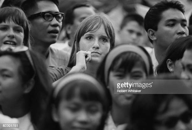 Two western women in the audience at a Beatles concert at the Rizal Memorial Football Stadium Manila Philippines during the group's final world tour...