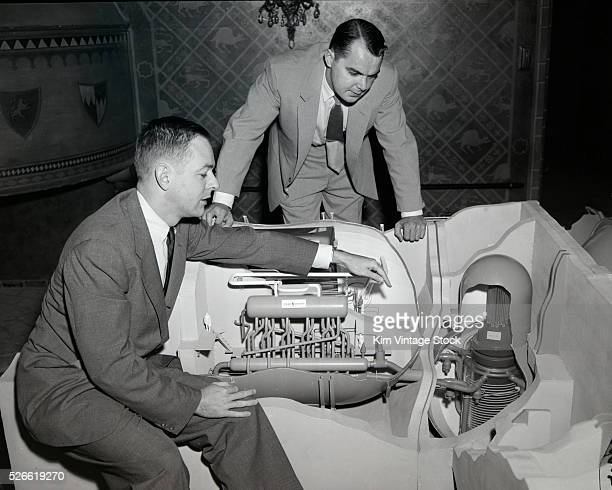 Two Westinghouse Electric Company scientists unveil a nuclear reactor model in the mid 1950s